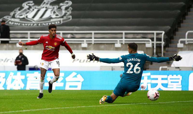 NEWCASTLE UPON TYNE, ENGLAND - OCTOBER 17: Marcus Rashford of Manchester United scores his team's fourth goal past Karl Darlow of Newcastle United during the Premier League match between Newcastle United and Manchester United at St. James Park on October 17, 2020 in Newcastle upon Tyne, England. Sporting stadiums around the UK remain under strict restrictions due to the Coronavirus Pandemic as Government social distancing laws prohibit fans inside venues resulting in games being played behind closed doors. (Photo by Alex Pantling/Getty Images)