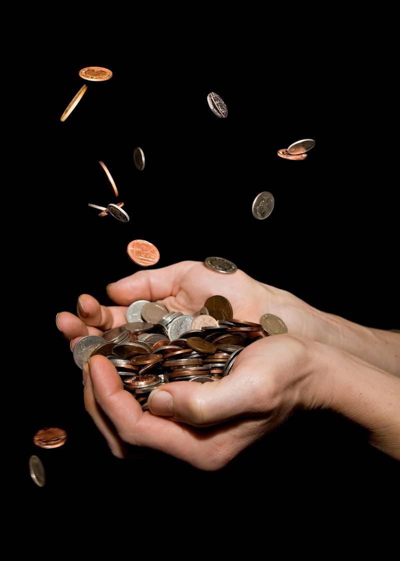 Caucasian male (42 yrs old) with hands held out trying to catch money, depicting the concept 'its raining money' or 'money falling from the sky' or 'pennies from heaven'