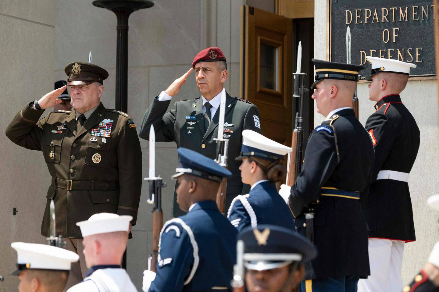 Chairman of the Joint Chiefs of Staff Army General Mark Milley (L) hosts an enhanced honor cordon for the Israeli Chief of Defense LTG Aviv Kohavi at the Pentagon in Washington, DC, on June 21, 2021. / AFP / JIM WATSON