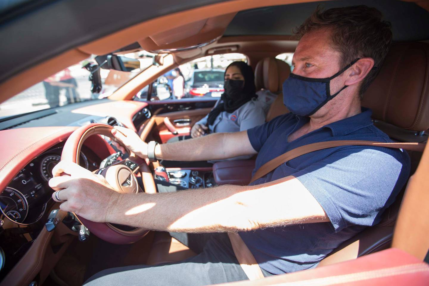 Dubai, United Arab Emirates - Driving instructor Zubeida with a Bentley car instructing Nick Webster at the Emirates Driving Institute, Dubai.  Leslie Pableo for The National