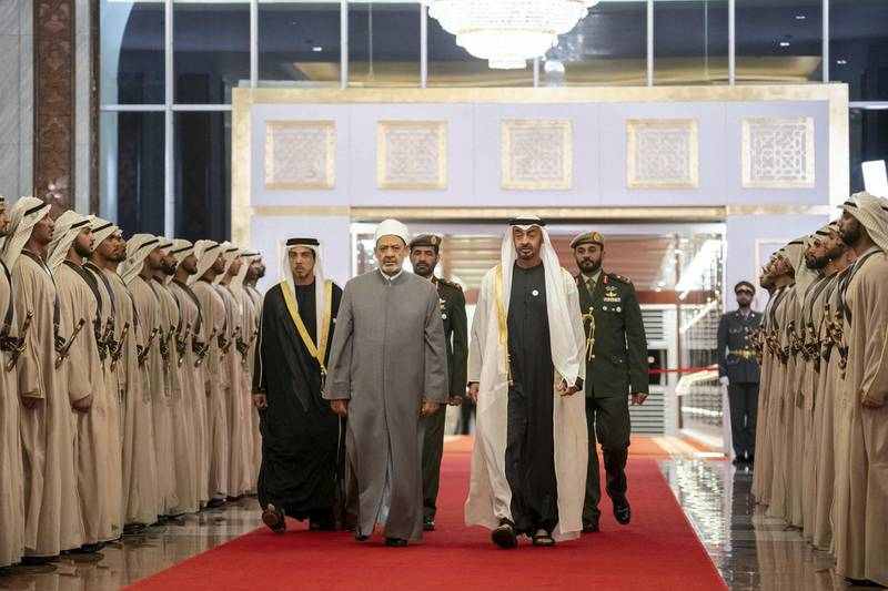 ABU DHABI, UNITED ARAB EMIRATES - February 3, 2019: Day one of the UAE papal visit - HH Sheikh Mohamed bin Zayed Al Nahyan, Crown Prince of Abu Dhabi and Deputy Supreme Commander of the UAE Armed Forces (front R), receives His Eminence Dr Ahmad Al Tayyeb, Grand Imam of the Al Azhar Al Sharif (front 2nd R), at the Presidential Airport.  ( Ryan Carter / Ministry of Presidential Affairs ) ---