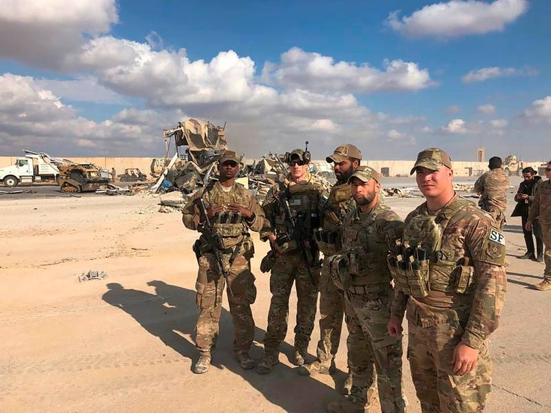 FILE - In this Jan. 13, 2020 file photo, U.S. Soldiers stand at a site of Iranian bombing at Ain al-Asad air base in Anbar, Iraq. On Tuesday, March 23, 2021, Iraqi officials said Iraq has sent a formal request to President Joe Biden's administration for a date to resume strategic talks on bilateral relations and the withdrawal of remaining U.S. combat forces. The talks, which began in June under the Trump administration, would be the first under Biden, who assumed office in January. (AP Photo/Qassim Abdul-Zahra, File)