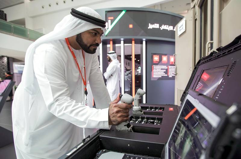 Abu Dhabi, United Arab Emirates, February 24, 2020.  The Unmanned Systems Exhibition and Conference (UMEX 2020) and Simulation Exhibition and Conference (SimTEX 2020).--  Ahmed Al Shehhi domonstrates the EARTH, remote control container system.Victor Besa / The NationalSection:  NAReporter:  None