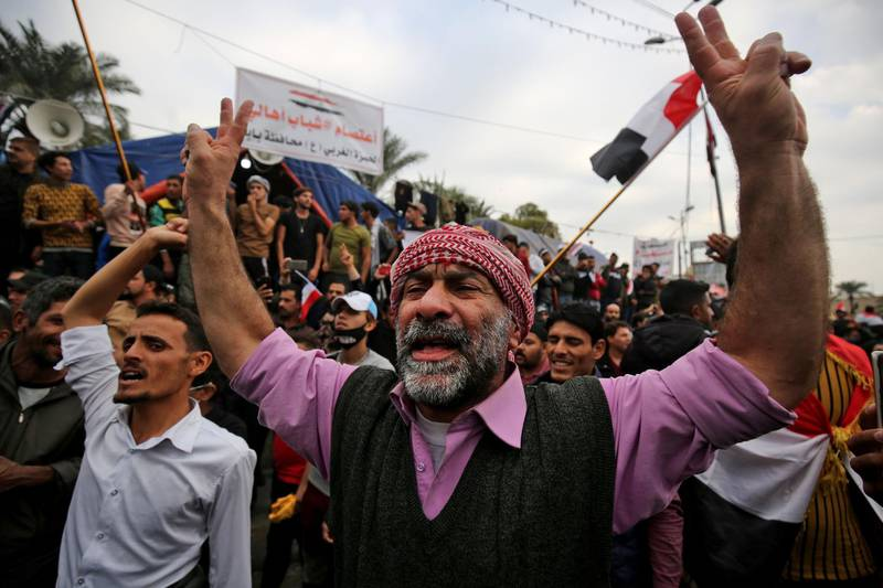 Iraqi demonstrators shout slogans as thee take part in an anti-government demonstration in the capital Baghdad's Tahrir Square, on December 6, 2019.  Tahrir has become a melting pot of Iraqi society, occupied day and night by thousands of demonstrators angry with the political system in place since the aftermath of the US-led invasion of 2003 and Iran's role in propping it up. / AFP / AHMAD AL-RUBAYE