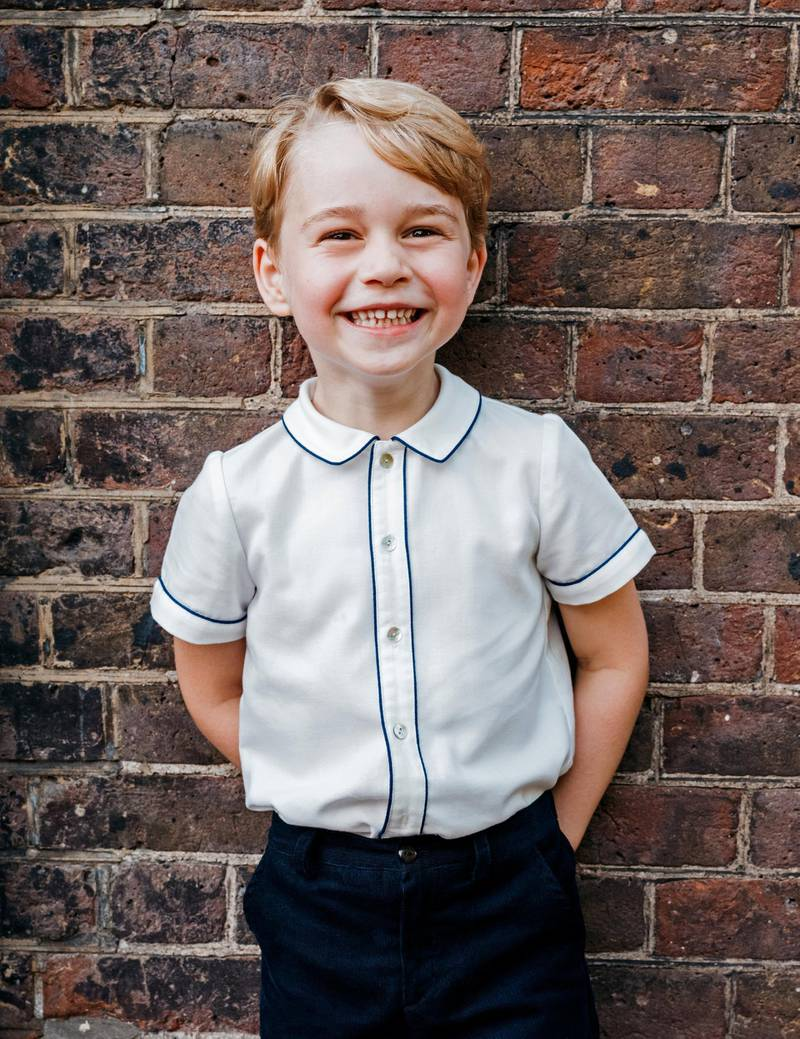 Britain's Prince George, son of Prince William and Catherine, Duchess of Cambridge, poses for a photograph to mark his 5th birthday on Sunday 22nd July, in the garden at Clarence House in central London, Britain, July 9, 2018. Picture taken July 9, 2018. Matt Porteous/Kensington Palace/Handout via REUTERS  - ATTENTION EDITORS - THIS IMAGE HAS BEEN SUPPLIED BY A THIRD PARTY. NO RESALES. NO ARCHIVES. NOT FOR USE AFTER DECEMBER 31, 2018 WITHOUT PRIOR PERMISSION FROM KENSINGTON PALACE. COPYRIGHT IN THE PHOTOGRAPH IS VESTED IN THE DUKE AND DUCHESS OF CAMBRIDGE. THE PHOTOGRAPH MUST NOT BE DIGITALLY ENHANCED, MANIPULATED OR MODIFIED IN ANY MANNER OR FORM.
