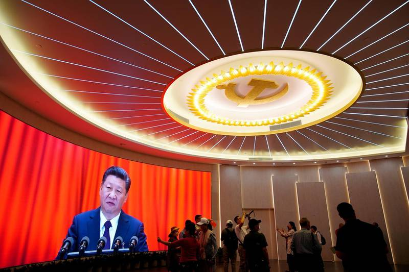 Chinese President Xi Jinping is shown on a screen during an event marking the 100th founding anniversary of the Communist Party of China at the Memorial of the First National Congress of the Communist Party of China in Shanghai, China June 4, 2021. REUTERS/Aly Song     TPX IMAGES OF THE DAY