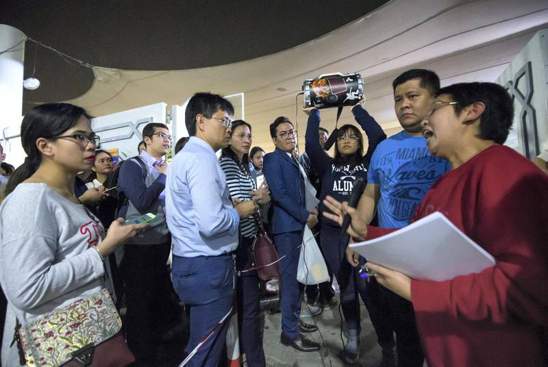 DUBAI, UNITED ARAB EMIRATES -A church volunteer giving instructions to the crowd at St. Mary's Catholic Church, Oud Mehta.  Leslie Pableo for The National for Patrick Ryan's story