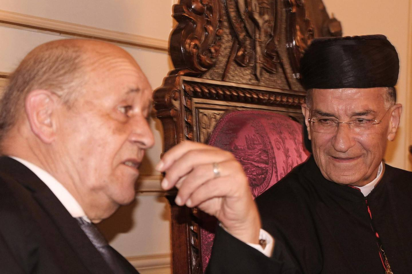 Lebanon's Christian Maronite patriarch Beshara Rai (R) meets with France's Foreign Minister Jean-Yves Le Drian in Bekerke north of Beirut on July 23, 2020. France's top diplomat was on a two-day visit to Lebanon in the first such trip in recent months by a high-ranking foreign politician to the crisis-hit country hoping for an international bailout. / AFP / -