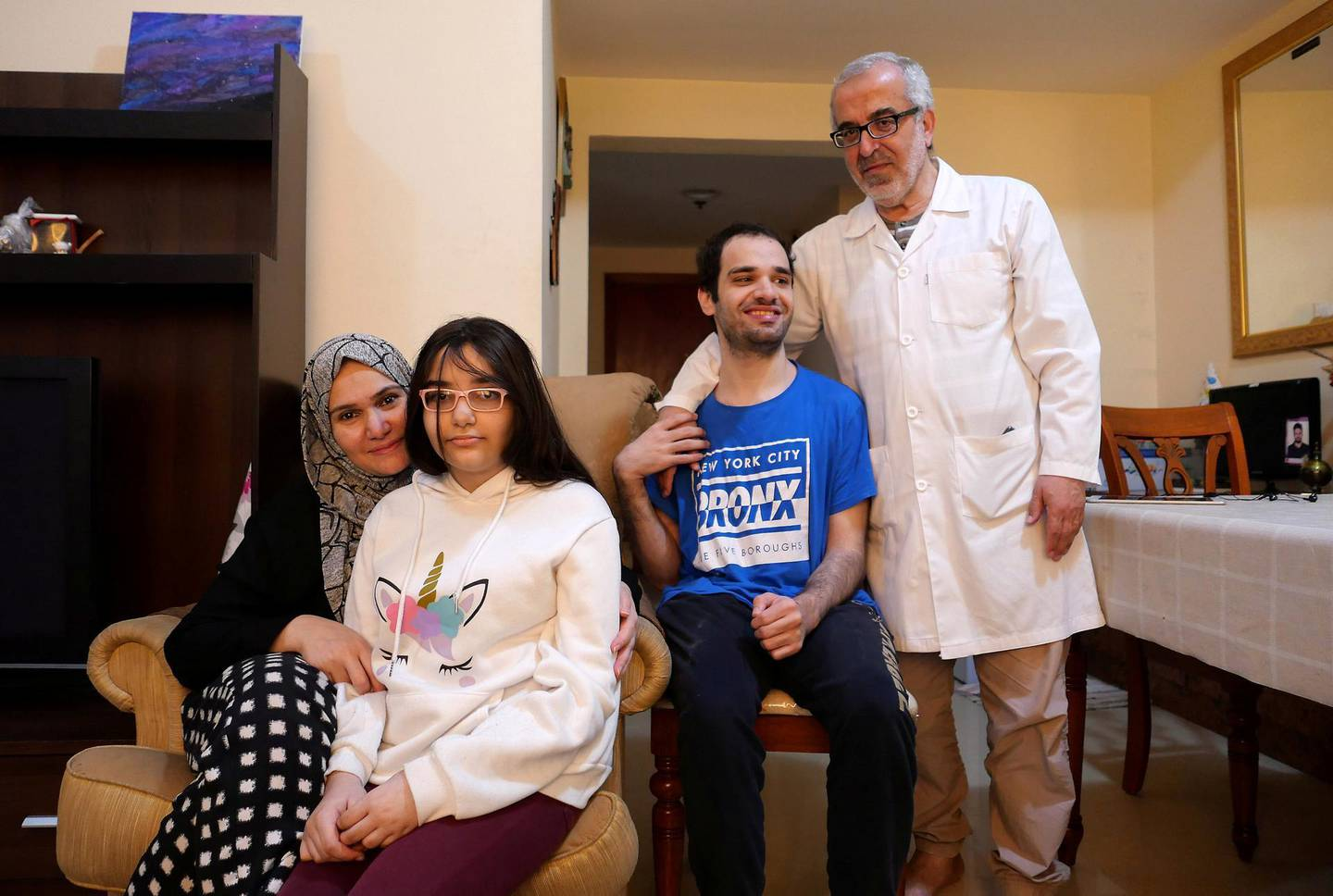 AJMAN, UNITED ARAB EMIRATES , March 14, 2021 – Jamal Abu Labam with his wife Manal Tamim , daughter Sama Abu Laban and son Almotaz bella Abu Laban from Syria at his apartment in Ajman. (Pawan Singh / The National) For News/Online/Instagram. Story by Haneen