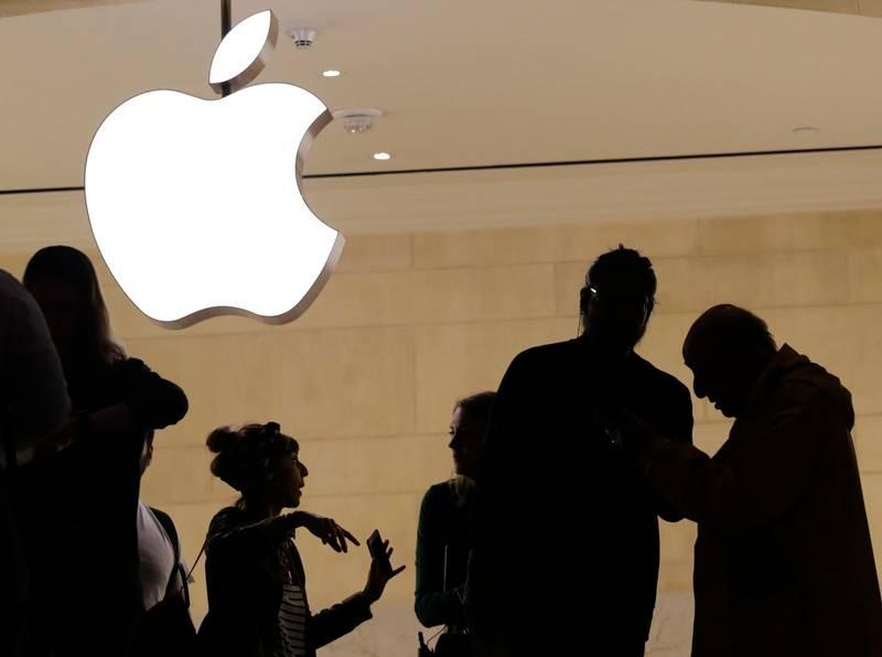In this May 31, 2018, photo, customers enter the Apple store in New York. Apple serves up fiscal third-quarter results Tuesday, July 31. The iPhone maker is expected to extend its string of solid earnings and revenue growth with its latest quarterly report card. (AP Photo/Mark Lennihan)