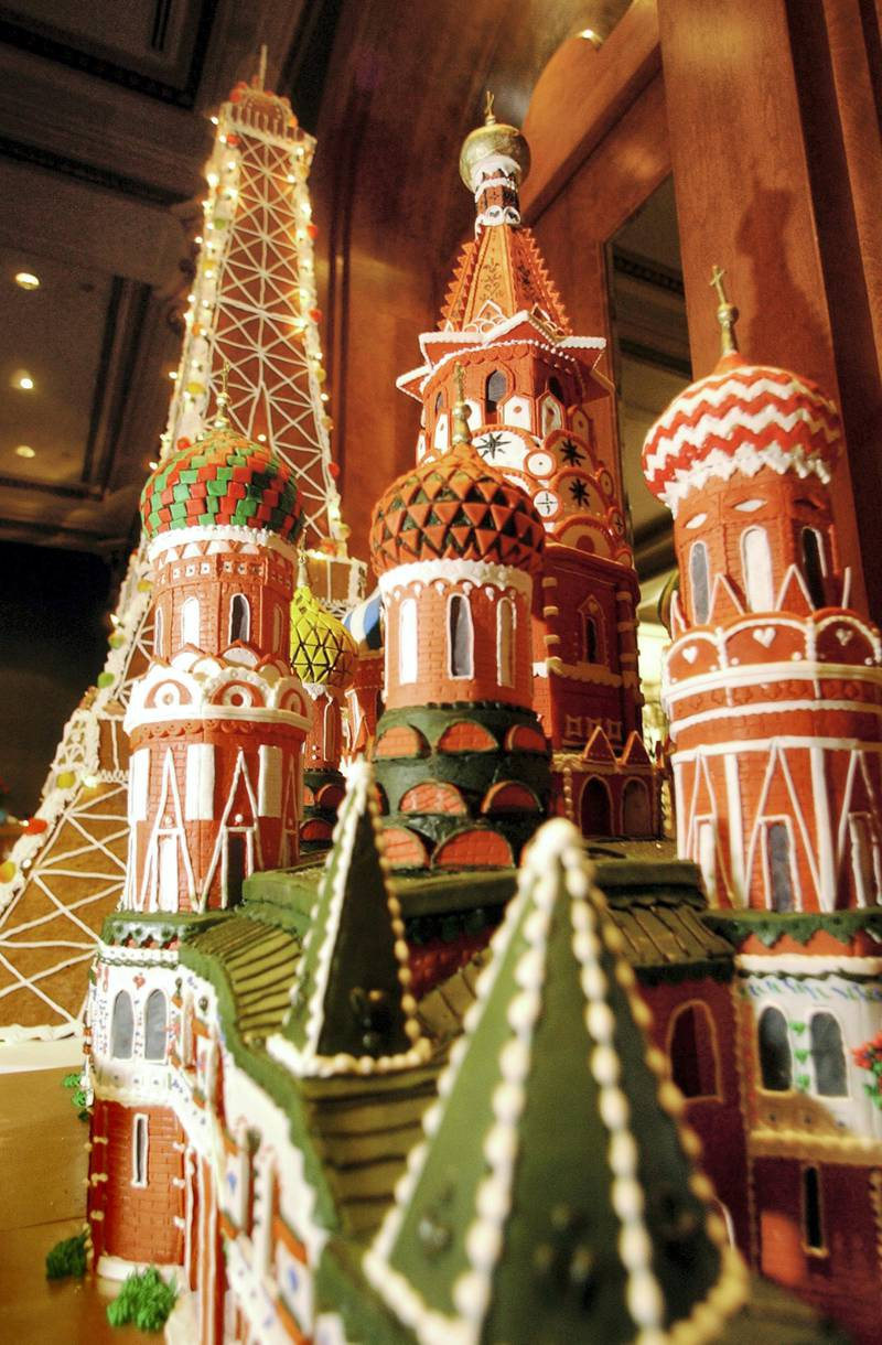 """SAN DIEGO, CA - DECEMBER 6:  A gingerbread replica of St. Basil's Cathedral in Russia, with a replica of the Eiffel Tower in the background, is displayed in the lobby of the U.S. Grant Hotel December 6, 2002 in San Diego, California.  The structure was part of the Gingerbread City 2002 contest, which raised money for the Epilepsy Foundation of San Diego County and were designed by local chefs, designers and artists. This year's theme was """"Architecture Through the Ages"""" and featured a seven-foot Eiffel Tower, Egyptian Pyramids, a replica of the Chrystler Building, along with other structures.  (Photo by Sandy Huffaker/Getty Images)"""