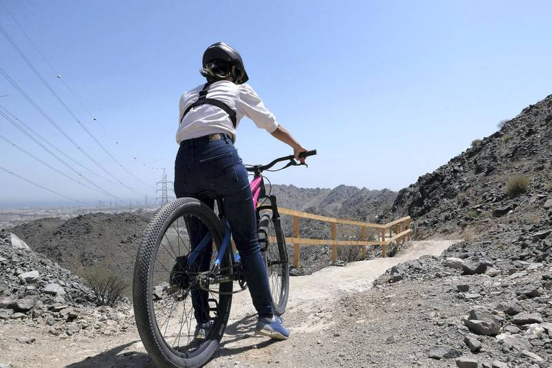 FUJAIRAH, UNITED ARAB EMIRATES , March 23, 2021 – Janice Rodrigues riding the cycle at the Fujairah Adventures Park in Fujairah. (Pawan Singh / The National) For Instagram/Online/ Lifestyle. Story by Janice Rodrigues