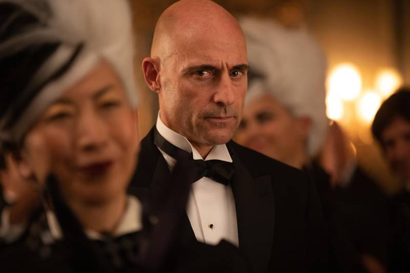 Mark Strong as Boris in Disney's live action CRUELLA. Photo by Laurie Sparham. © 2021 Disney Enterprises, Inc.All Rights Reserved.