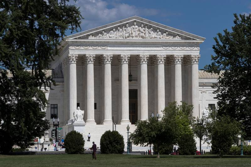 In this June 26, 2017 file photo, The Supreme Court is seen on the last day of its term, in Washington.  The Trump administration is back at the Supreme Court, asking the justices to continue to allow strict enforcement of a temporary ban on refugees from around the world. The Justice Department's high court filing Monday follows an appeals court ruling last week that would allow refugees to enter the United States if a resettlement agency in the U.S. had agreed to take them in.  (AP Photo/J. Scott Applewhite)