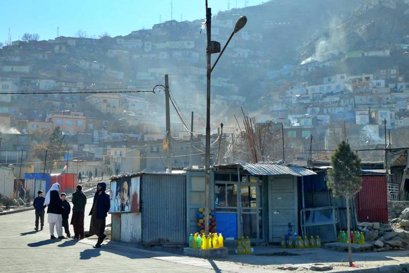 Pictured: Residents chatter in the street in central Kabul on a chilly but sunny December morning. Photo by Charlie Faulkner