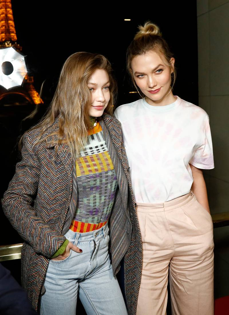 """PARIS, FRANCE - FEBRUARY 25: Models Gigi Hadid and Karlie Kloss attend the launch of Evian and Virgil Abloh's limited-edition """"One Drop can make a Rainbow"""" collection at Theatre National de Chaillot, Paris, on Monday February 25th. (Photo by Julien M. Hekimian/Getty Images for EVIAN)"""