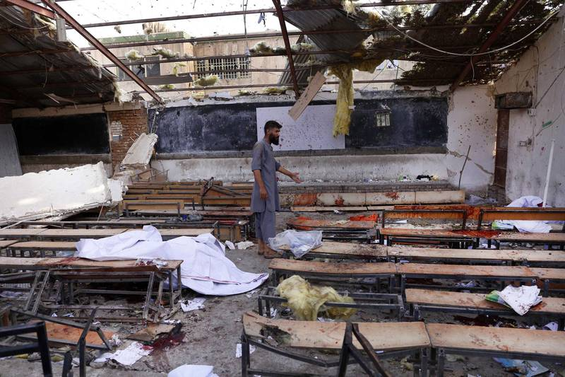 epa06951173 Afghan man inspects the scene of a suicide bomb attack in Kabul, Afghanistan, 15 August 2018. At least 25 people were killed when a suicide bomber attacked an educational institute frequented by the Shi'ite Muslims in Kabul.  EPA/HEDAYATULLAH AMID