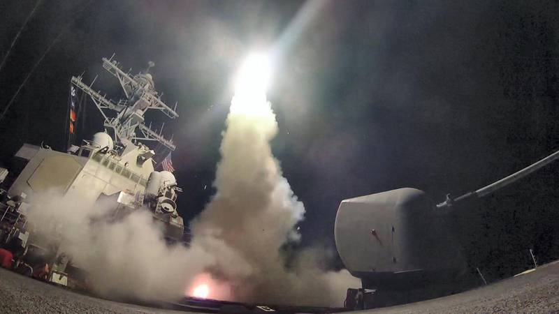 """In this image released by the US Navy, the guided-missile destroyer USS Porter conducts strike operations while in the Mediterranean Sea, April 7, 2017.    US President Donald Trump ordered a massive military strike on a Syrian air base on Thursday in retaliation for a """"barbaric"""" chemical attack he blamed on President Bashar al-Assad. The missiles were fired from the USS Porter and the USS Ross, which belong to the US Navy's Sixth Fleet and are located in the eastern Mediterranean. / AFP PHOTO / US NAVY / Ford WILLIAMS / RESTRICTED TO EDITORIAL USE - MANDATORY CREDIT """"AFP PHOTO / US NAVY / Mass Communication Specialist 3rd Class Ford Williams"""" - NO MARKETING NO ADVERTISING CAMPAIGNS - DISTRIBUTED AS A SERVICE TO CLIENTS"""