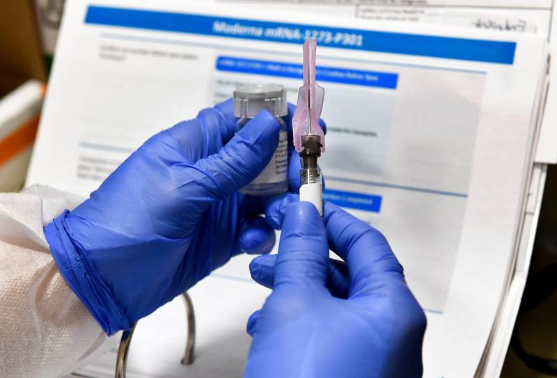 FILE - In this July 27, 2020, file photo, nurse Kathe Olmstead prepares a shot that is part of a possible COVID-19 vaccine, developed by the National Institutes of Health and Moderna Inc., in Binghamton, N.Y. Moderna said Monday, Nov. 16, 2020, its COVID-19 shot provides strong protection against the coronavirus that's surging in the U.S. and around the world. (AP Photo/Hans Pennink, File)
