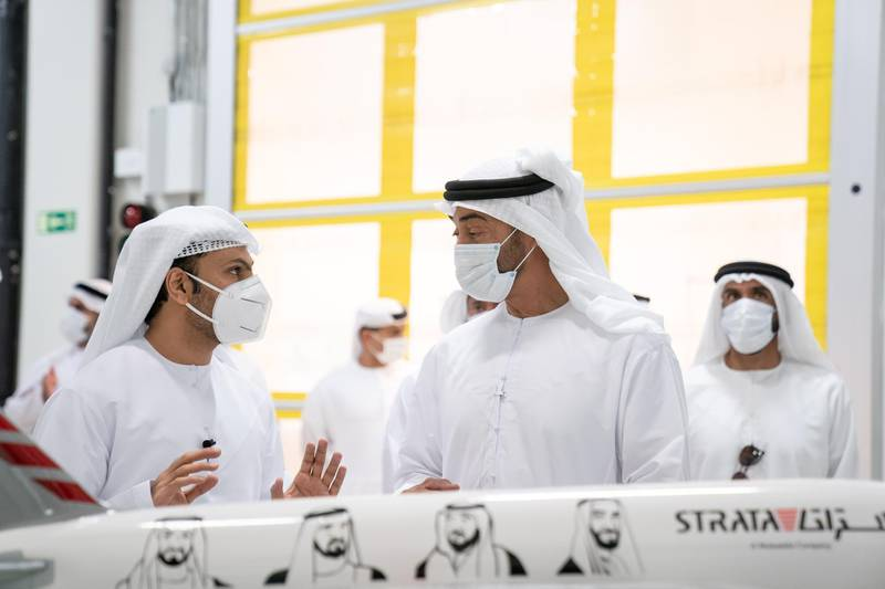 AL AIN, ABU DHABI, UNITED ARAB EMIRATES - June 24, 2020: HH Sheikh Mohamed bin Zayed Al Nahyan, Crown Prince of Abu Dhabi and Deputy Supreme Commander of the UAE Armed Forces (R) visits Strata Manufacturing PJSC, at Al Ain International airport. Seen with HH Sheikh Nahyan Bin Zayed Al Nahyan, Chairman of the Board of Trustees of Zayed bin Sultan Al Nahyan Charitable and Humanitarian Foundation (back R).  ( Eissa Al Hammadi for the Ministry of Presidential Affairs ) ---