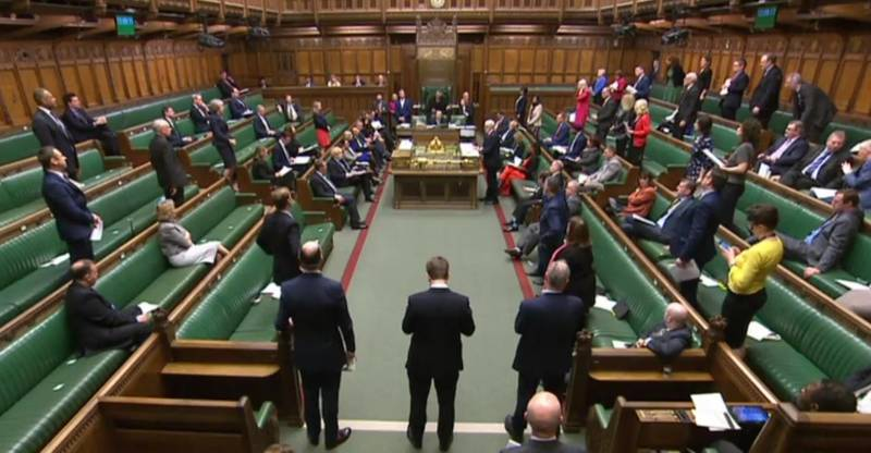 """A video grab from footage broadcast by the UK Parliament's Parliamentary Recording Unit (PRU) shows Members of Parliament in the chamber as the weekly Prime Minister's Question time (PMQs) is underway in the House of Commons in London on March 18, 2020. The British government will on Wednesday unveil a raft of emergency powers to deal with the coronavirus epidemic, including proposals allowing police to detain potentially infected people to be tested. - RESTRICTED TO EDITORIAL USE - MANDATORY CREDIT """" AFP PHOTO / PRU """" - NO USE FOR ENTERTAINMENT, SATIRICAL, MARKETING OR ADVERTISING CAMPAIGNS  / AFP / PRU / - / RESTRICTED TO EDITORIAL USE - MANDATORY CREDIT """" AFP PHOTO / PRU """" - NO USE FOR ENTERTAINMENT, SATIRICAL, MARKETING OR ADVERTISING CAMPAIGNS"""