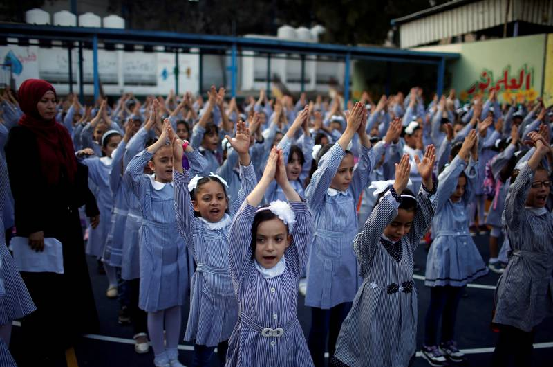 Palestinian schoolgirls participate in the morning exercise at an UNRWA-run school, on the first day of a new school year, in Gaza City August 29, 2018. REUTERS/Mohammed Salem TPX IMAGES OF THE DAY