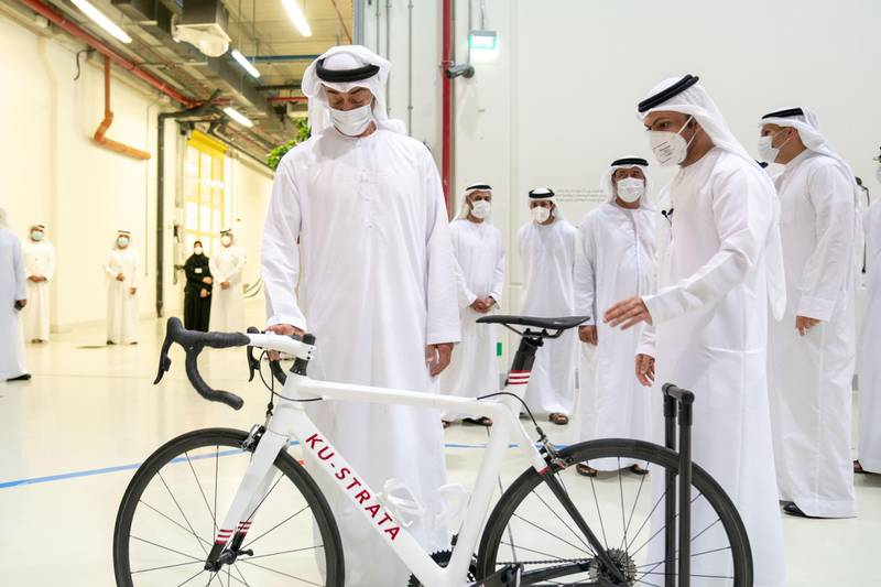 AL AIN, ABU DHABI, UNITED ARAB EMIRATES - June 24, 2020: HH Sheikh Mohamed bin Zayed Al Nahyan, Crown Prince of Abu Dhabi and Deputy Supreme Commander of the UAE Armed Forces (L) visits Strata Manufacturing PJSC, at Al Ain International airport.  ( Eissa Al Hammadi for the Ministry of Presidential Affairs ) ---