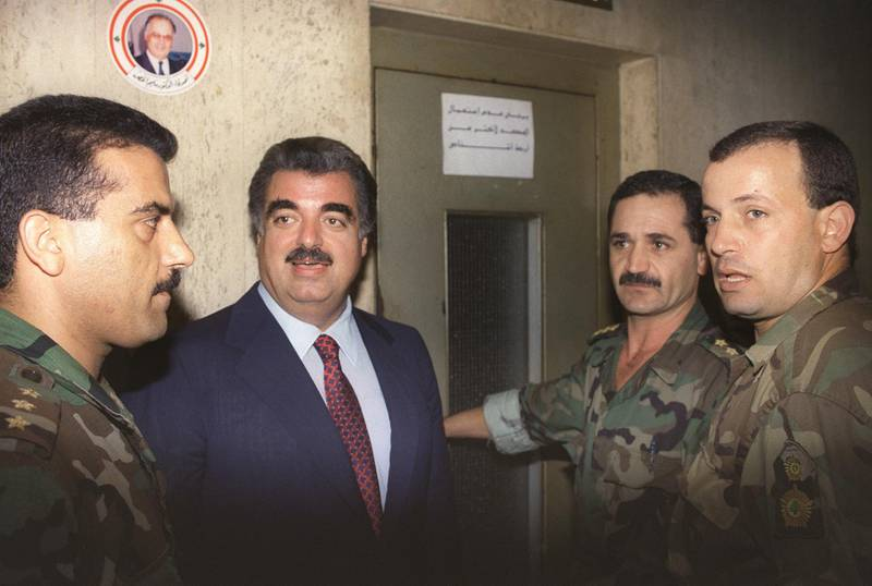 Lebanese Premier Rafic Hariri (2ndl) is seen 22 October 1992 in Beirut, after being nominated as Prime Minister by President Elias Hrawi. (Photo by NABIL ISMAIL / AFP)
