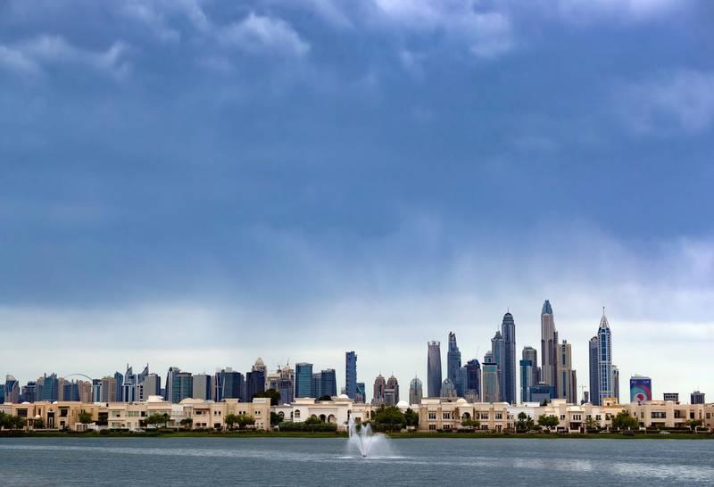 Dubai, United Arab Emirates - April 10, 2019: Dark clouds over the Dubai skyline. Wednesday the 10th of April 2019. The Springs, Dubai. Chris Whiteoak / The National