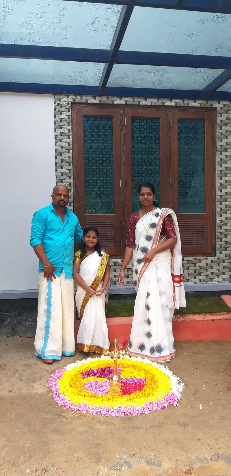 Soumya Devi, her husband Hari Prasad and their elder daughter Bhadra in their hometown of Kerala in southern India. The family tells of home amid the coronavirus pandemic. Courtesy: Hari Prasad
