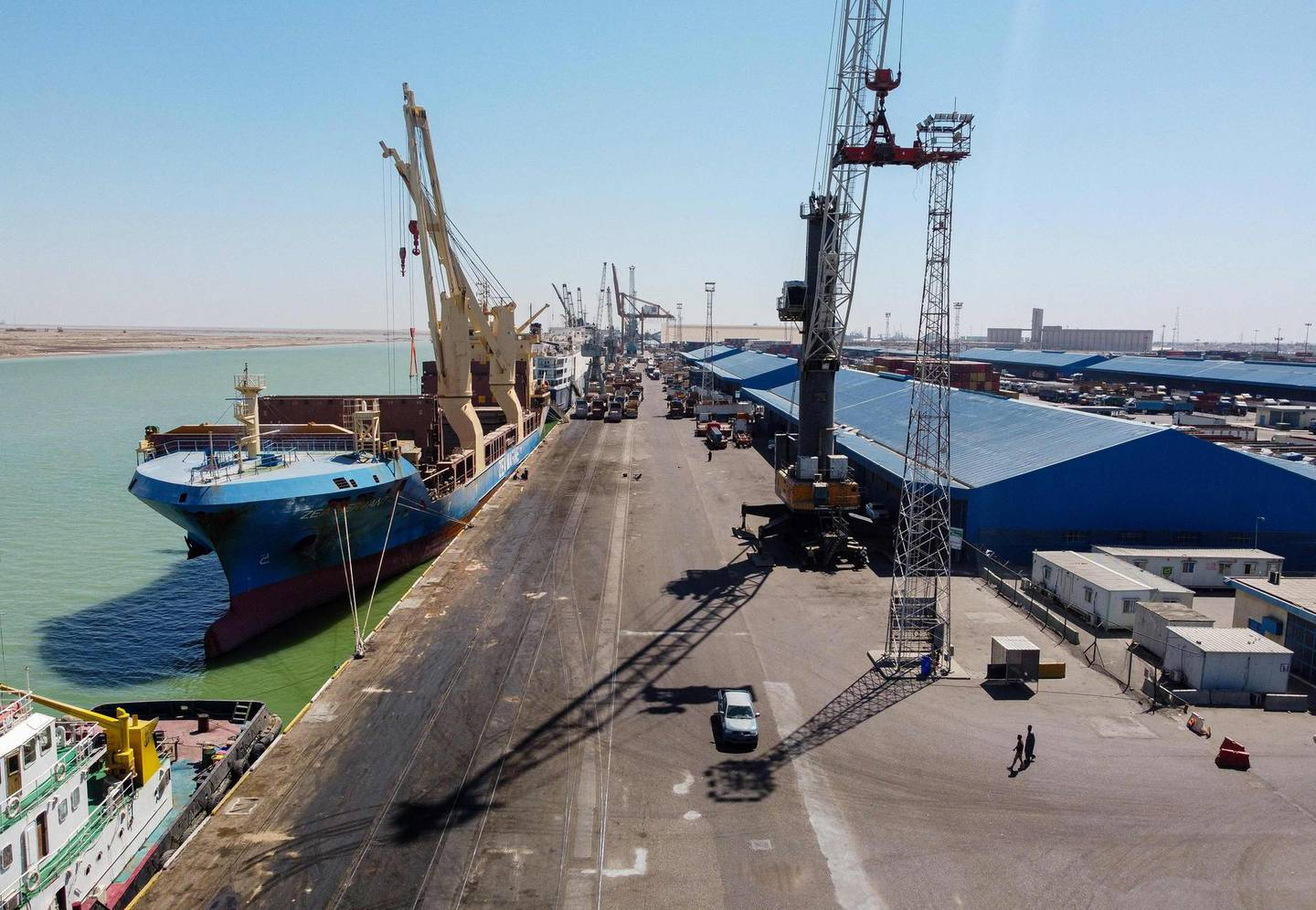 This picture taken on March 14, 2021 shows a view of the Hong Kong-flagged cargo vessel Zea Servant while moored at the port of Umm Qasr, south of Iraq's southern city of Basra. Iraq is ranked the 21st most corrupt country by Transparency International. In January, the advocacy group said public corruption had deprived Iraqis of basic rights and services, including water, health care, electricity and jobs. It said systemic graft was eating away at Iraqis' hopes for the future, pushing growing numbers to try to emigrate. In 2019, hundreds of thousands of protesters flooded Iraqi cities, first railing against poor public services, then explicitly accusing politicians of plundering resources meant for the people. / AFP / Hussein FALEH