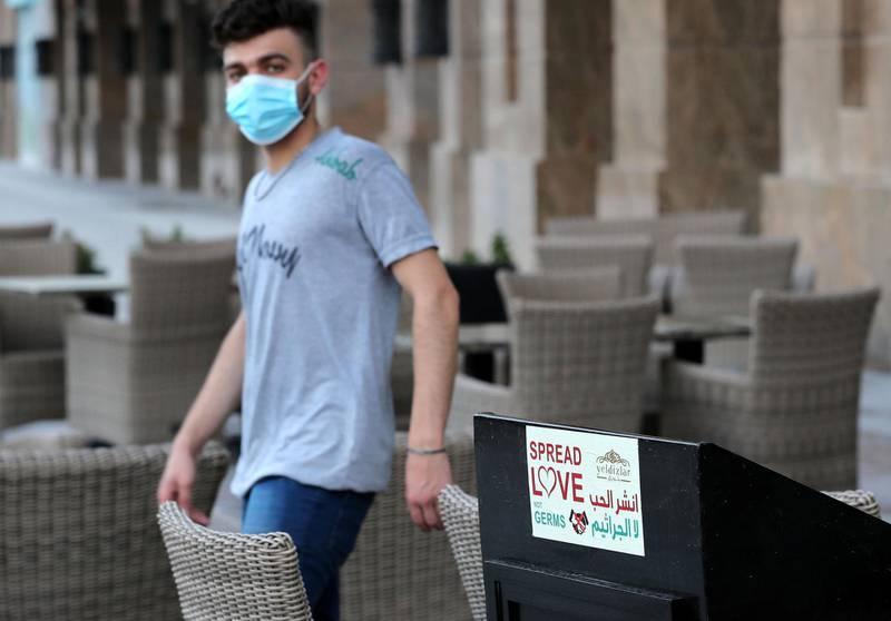 Dubai, United Arab Emirates - Reporter: N/A: Coronavirus / Covid-19. A sign at Yeldizlar restaurant near the Burj Khalifa says 'Spread Love not Germs' after the lifting of the 24hr lockdown. Saturday, April 25th, 2020. Dubai. Chris Whiteoak / The National