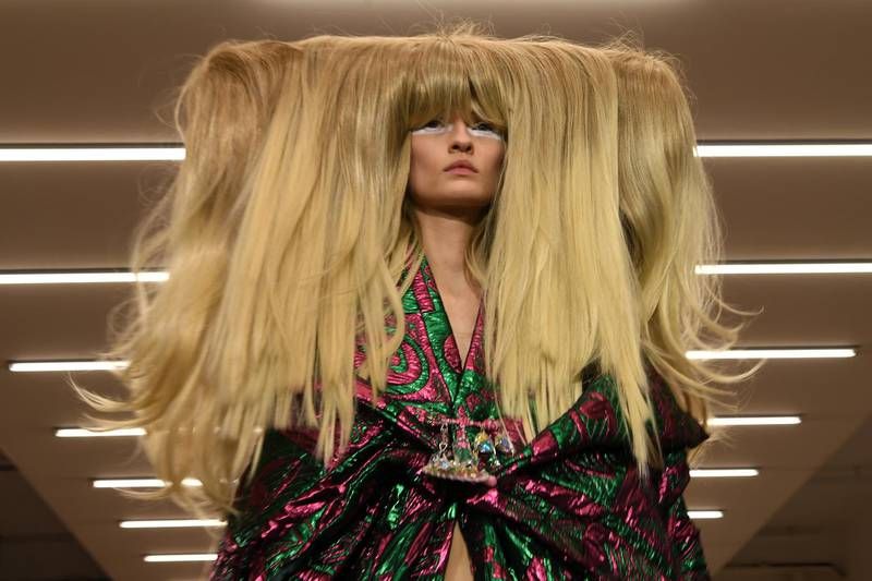 A model presents a creation by designer Matty Bovan during the catwalk show for their Autumn/Winter 2020 collection on the first day of London Fashion Week in London on February 14, 2020. (Photo by DANIEL LEAL-OLIVAS / AFP)