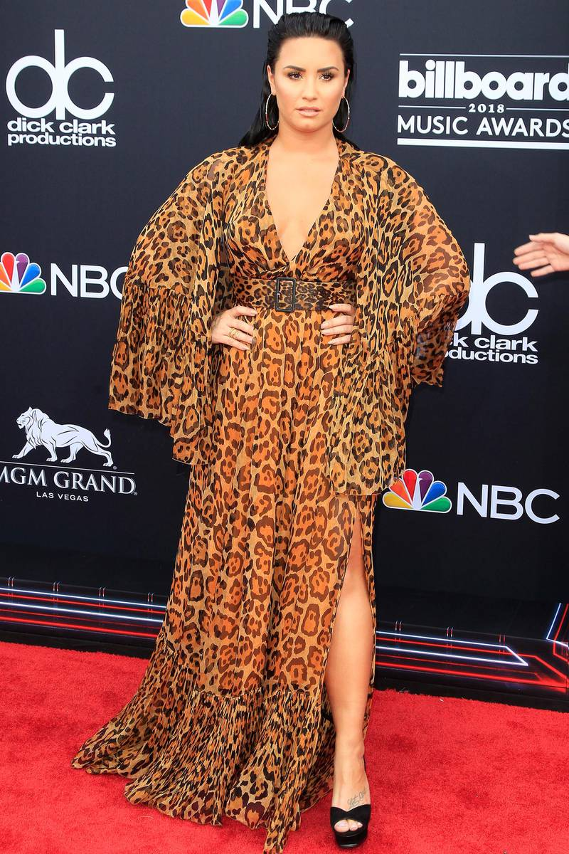 epa06753670 Demi Lovato arriving for the 2018 Billboard Music Awards at the MGM Grand Garden Arena in Las Vegas, Nevada, USA, 20 May 2018. The Billboard Music Awards finalists are based on US year-end chart performance, sales, number of downloads and total airplay.  EPA-EFE/NINA PROMMER