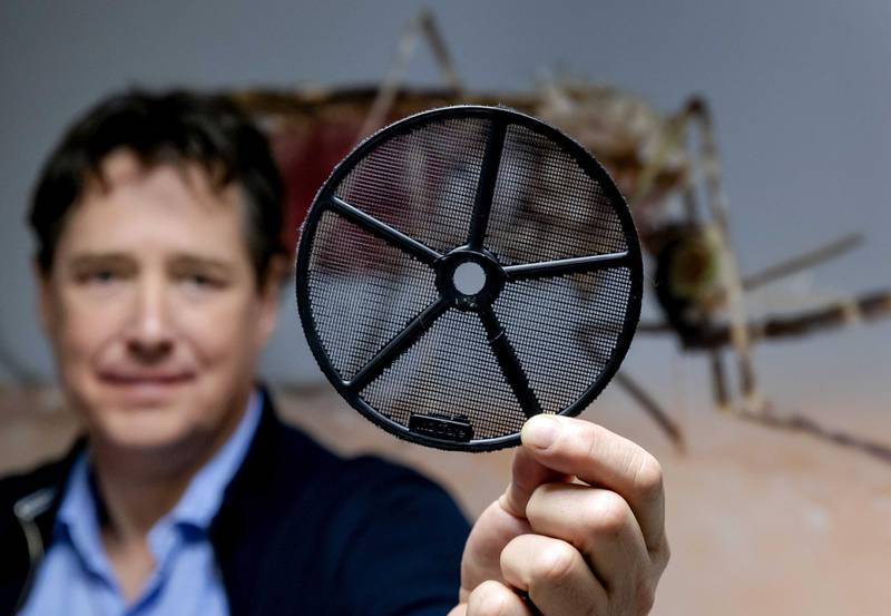 epa09044952 Dr. Tim Mohlmann shows a disc with mesh of the so-called EaveTube system in Wageningen, The Netherlands, 01 March 2021. The invention by the company In2Care, a special ventilation pipe for homes, containing a mosquito net impregnated with insecticides, reduces the risk of malaria.  EPA-EFE/ROBIN VAN LONKHUIJSEN