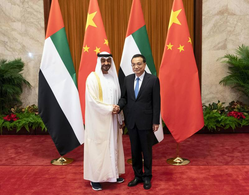 BEIJING, CHINA - July 22, 2018: HH Sheikh Mohamed bin Zayed Al Nahyan, Crown Prince of Abu Dhabi and Deputy Supreme Commander of the UAE Armed Forces (L) stands for a photograph with HE Li Keqiang, Premier of the State Council of China (R), at the Great Hall of the People.  ( Rashed Al Mansoori / Ministry of Presidential Affairs ) ---