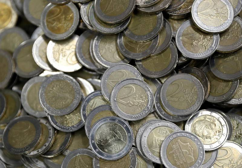 Two Euro coins are seen at the Money Service Austria company's headquarters in Vienna, Austria, November 16, 2017. REUTERS/Leonhard Foeger