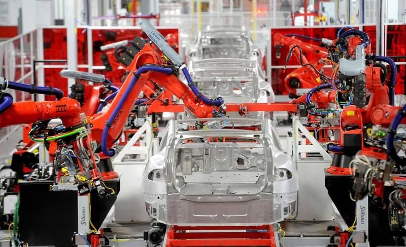 FILE PHOTO: Robotic arms assemble Tesla's Model S sedans at the company's factory in Fremont, California, June 22, 2012.  REUTERS/Noah Berger/File Photo