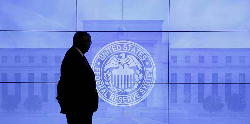 FILE PHOTO: A security guard walks in front of an image of the Federal Reserve before the arrival of U.S. Federal Reserve Chair Janet Yellen to give a news conference following the two-day Federal Open Market Committee (FOMC) policy meeting in Washington, March 16, 2016. REUTERS/Kevin Lamarque/File Photo