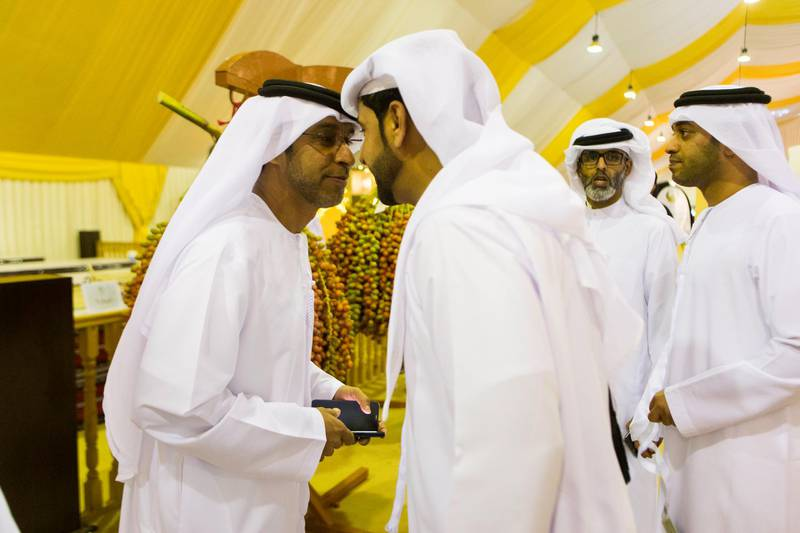 Liwa, United Arab Emirates, July 20, 2017:    Emirati men attend the Liwa Date Festival in the Al Dhafra Region of Abu Dhabi on July 20, 2017. The festival runs from July 19th to 29th. Christopher Pike / The NationalReporter: Anna ZachariasSection: News