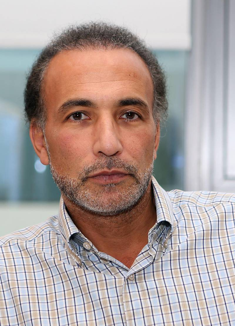 (FILES) This file photo taken on December 14, 2015 shows Swiss Islamologist Tariq Ramadan posing in his office at the Qatar Foundation in Doha.  A third woman has filed rape complaints against the prominent Islamic scholar Tariq Ramadan, already indicted over similar charges and in custody, judicial sources told AFP on March 7, 2018. / AFP PHOTO / Karim JAAFAR