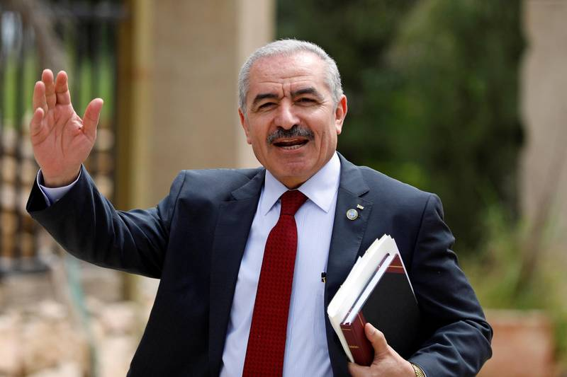 Palestinian Prime Minister Mohammad Shtayyeh gestures as he arrives for a cabinet meeting of the new Palestinian government, in Ramallah, in the Israeli-occupied West Bank April 15, 2019. REUTERS/Mohamad Torokman
