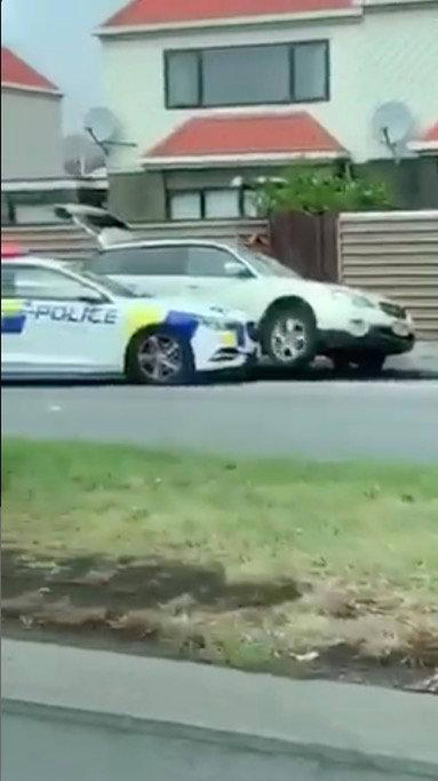 """A police car blocks the car of a suspect following shootings at two mosques in Christchurch, New Zealand March 15, 2019, in this still image obtained from a social media video. Courtesy of Twitter @ROBERT22041432/Social Media via REUTERS. ATTENTION EDITORS - THIS IMAGE HAS BEEN SUPPLIED BY A THIRD PARTY. MANDATORY CREDIT """"TWITTER / @ROBERT22041432"""". NO RESALES. NO ARCHIVES."""