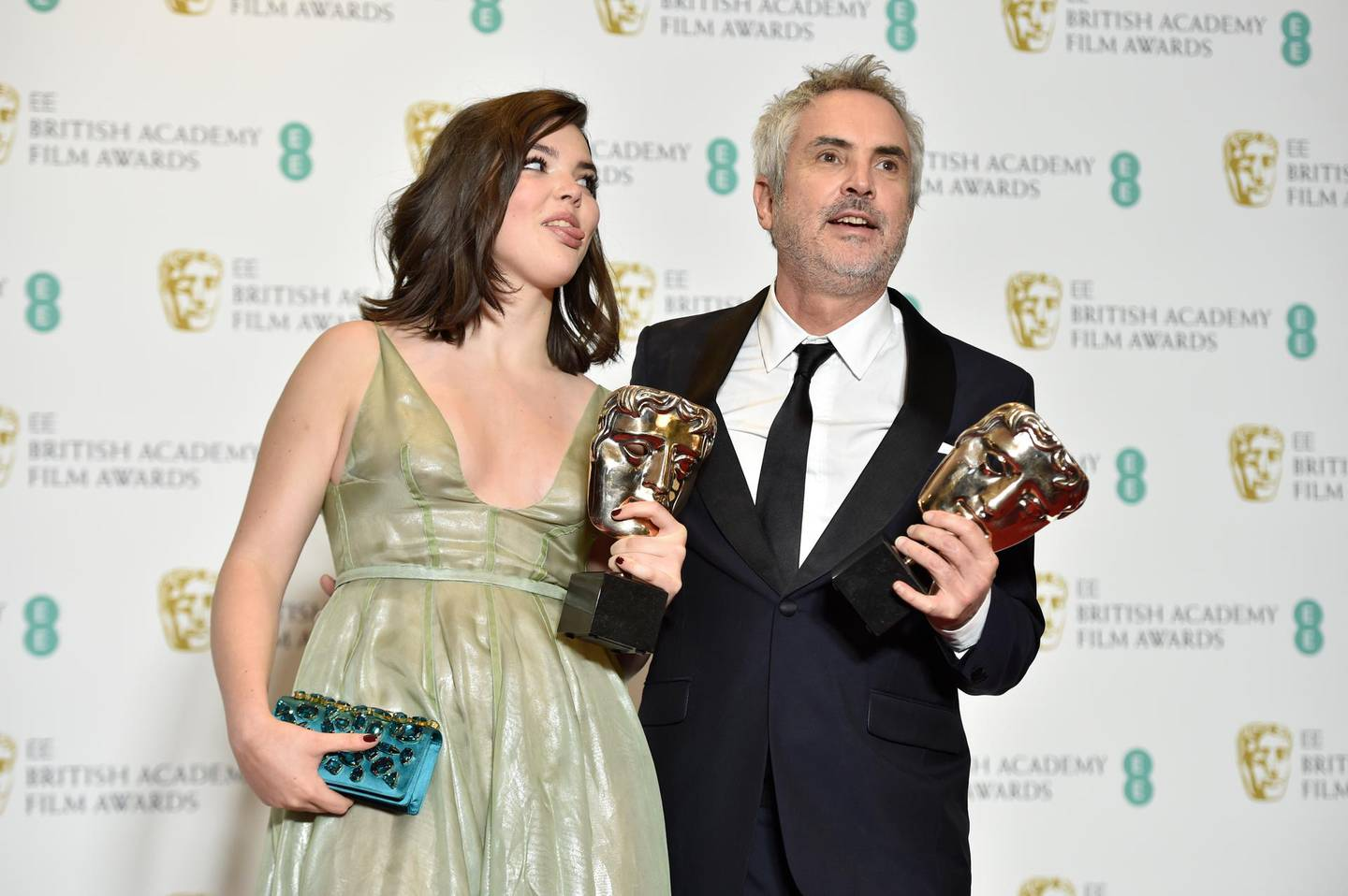 epa07360670 Mexican director Alfonso Cuaron (R) and his daughter Tessa pose with the awards for Best Film and Best Director for 'Roma' in the press room during the 72nd annual British Academy Film Awards at the Royal Albert Hall in London, Britain, 10 February 2019. The ceremony is hosted by the British Academy of Film and Television Arts (BAFTA).  EPA/NIK HALLEN