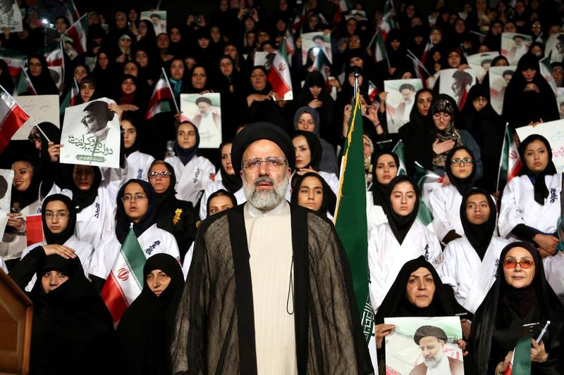 FILE -- In this April 29, 2017 file photo, hard-line cleric Ebrahim Raisi attends a 2017 presidential election rally in Tehran, Iran. On Thursday March 7, 2019, Iran's Supreme Leader Ayatollah Ali Khamenei named Raisi as the country's new judiciary chief. That's sparked concern from rights activists over his involvement in the execution of thousands in the 1980s. Raisi's selection comes after he was trounced by incumbent Hassan Rouhani in the country's 2017 presidential election. (AP Photo/Ebrahim Noroozi, File)