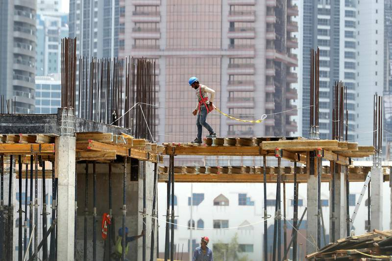 DUBAI, UNITED ARAB EMIRATES , June 11 – 2020 :- Workers at one of the construction site in Al Satwa area in Dubai.  The UAE's compulsory midday break for outdoor workers will start from June 15. (Pawan Singh / The National) For News/Standalone/Online/Stock