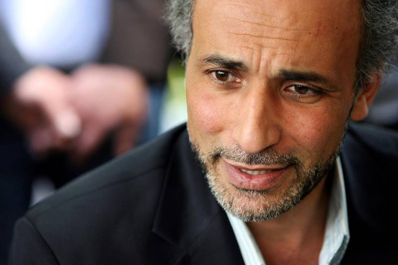 FILE PHOTO: Author Tariq Ramadan talks with a journalist after a conference at the Er-Rahma mosque in Nantes, France, April 25, 2010. Ramadan, a professor of Islamic studies at the University of Oxford, has been taken into custody by French police following accusations of rape, according to a judicial source, January 31, 2018.  Picture taken April 25, 2010.    REUTERS/Stephane Mahe/File Photo