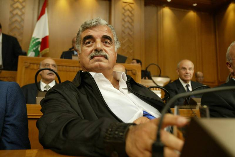 (FILES) In this file photo taken on September 3, 2004 Lebanese Prime Minister Rafiq Hariri attends a parliamentary session in Beirut. - The trial of four Hezbollah suspects in the assassination of Lebanese ex-prime minister Rafiq Hariri, killed in 2005, enters the final stretch on September 11, 2018 in a special UN-backed court in the Netherlands, with closing arguments in the long-running case. (Photo by Joseph BARRAK / AFP)