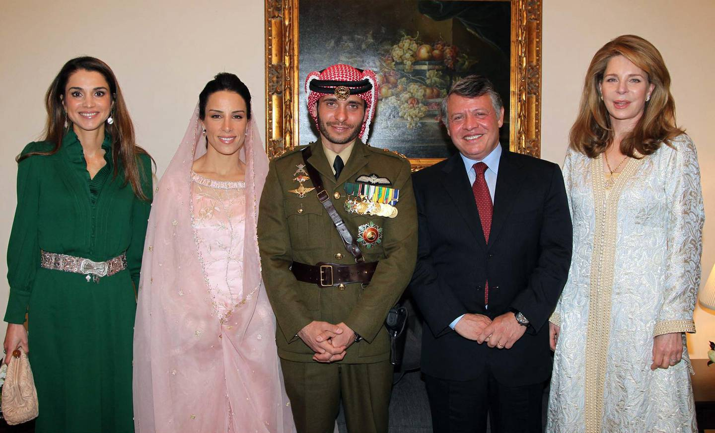 (FILES) In this file handout picture released by the Jordanian news agency Petra on January 12, 2012, shows Jordan's King Abdullah (2nd R), Queen Noor, widow of late King Hussein (R), and Queen Rania (L) posing for a picture with Prince Hamza, half-brother of Jordan's King Abdullah and his new wife Princess Basma Otoum during their  Muslim wedding ceremony at the Royal Palace in Amman . Prince Hamzah bin Hussein, a half-brother of King Abdullah II, has been asked to stop activities that could undermine Jordan's security, the army said April 3, 2021. The Joint Chiefs of Staff head, Major General Yousef Huneiti, also denied media reports that Hamza, a former crown prince, had been arrested.  / AFP / PETRA / YOUSEF ALLAN