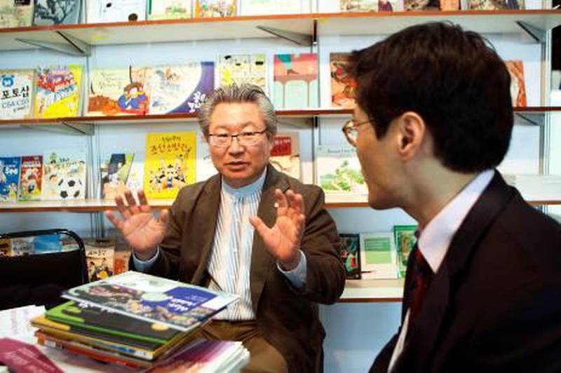 ABU DHABI, UNITED ARAB EMIRATES – March 15, 2011: Kim Dong Hwi, CEO of Yeowon Media, and Seung Hyun Moon, director of Korean Publishers Association, left to right, are interviewed at the Abu Dhabi International Book Fair about translating Korean children's books translated to Arabic.  Last year, 130 Korean children's books were translated to Arabic.   ( Andrew Henderson / The National )